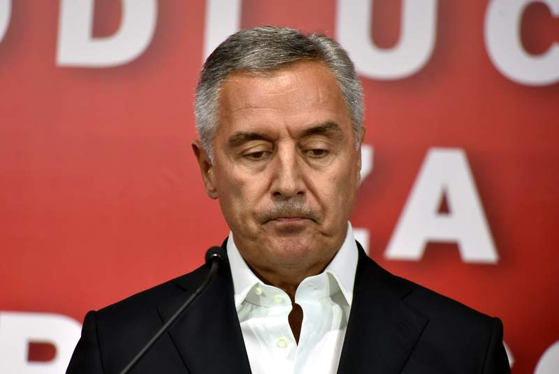 Montenegrin President Milo Djukanovic speaks in his DPS party headquarters in Podgorica, Montenegro, early Monday, Aug. 31, 2020. Montenegro's pro-Serb and Russian opposition groups claimed victory against the ruling pro-Western party in a tense parliamentary election that could see a change in the course of the small Balkan state. (AP Photo/Risto Bozovic)