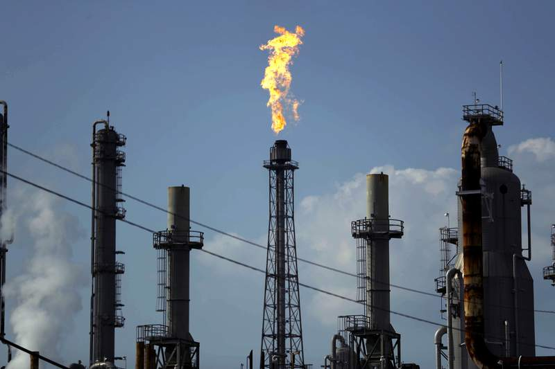 FILE - In this Aug. 31, 2017, file photo, a flame burns at the Shell Deer Park oil refinery in Deer Park, Texas. Mexico's President Andres Manuel Lopez Obrador said Monday, May 24, 2021, that it will buy Shell's 50% share in the jointly owned Deer Park refinery. (AP Photo/Gregory Bull, File)