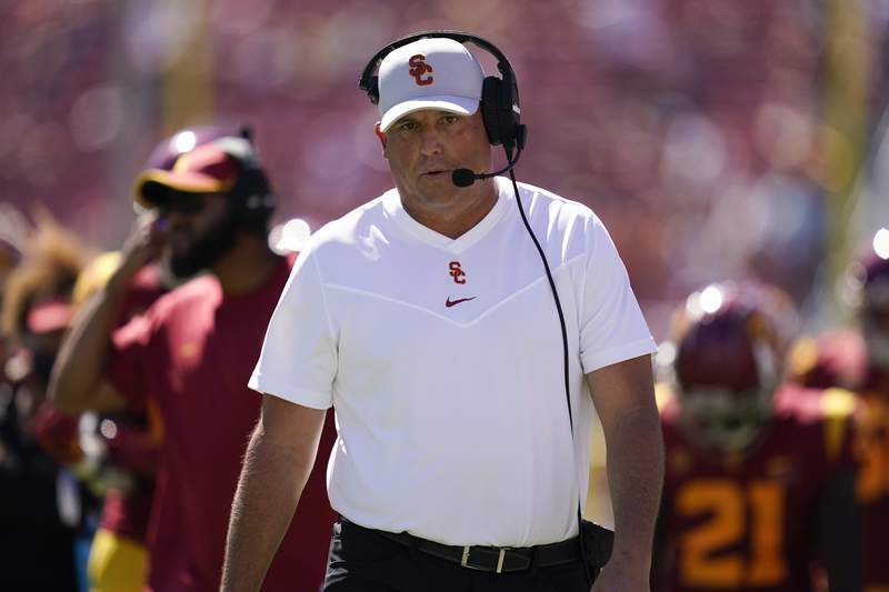 Southern California head coach Clay Helton walks on the sideline during an NCAA college football game against San Jose State Saturday, Sept. 4, 2021, in Los Angeles. (AP Photo/Ashley Landis)