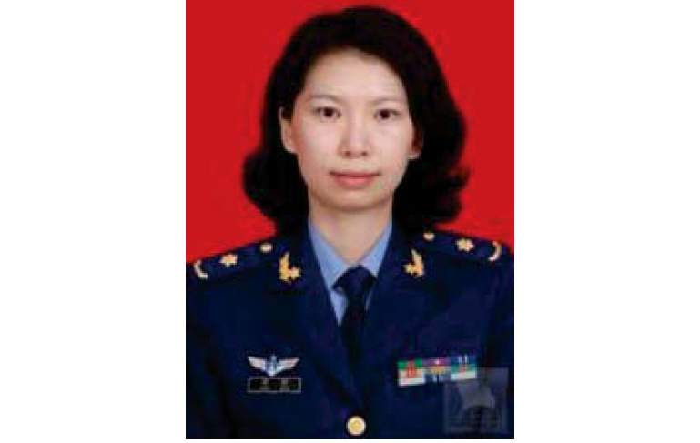 This undated photo provided by the U.S. Justice Department shows Juan Tang in her China People's Liberation Army military uniform.  The Justice Department on Thursday, July 23, 2020, says the Chinese consulate in San Francisco is harboring a Chinese researcher who lied about her military background.   The Justice Department says the scientist, who is listed in some court filings as Juan Tang, lied about her military affiliation in a visa application last October as she made plans to work at the University of California, Davis and again during an FBI interview months later.(Justice Department via AP)