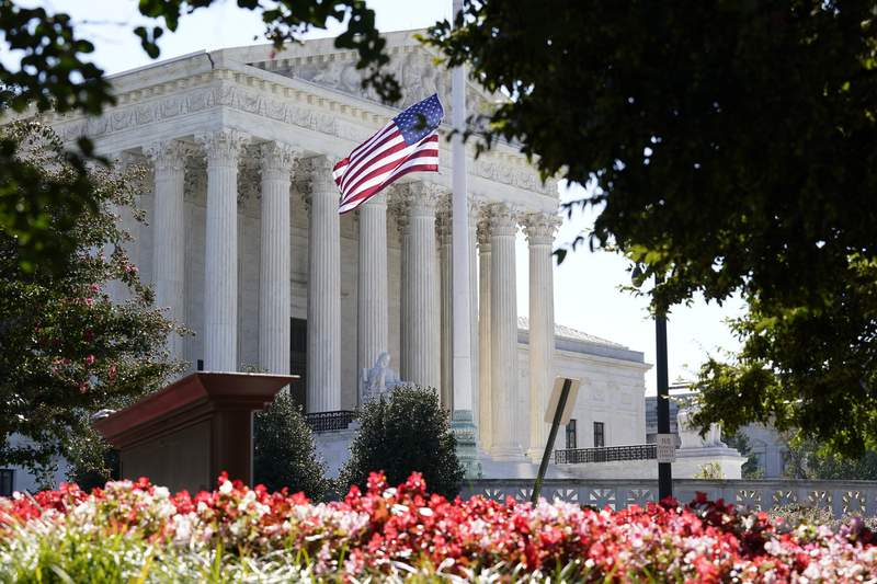 The Supreme Court is seen in Washington, Tuesday, Oct. 6, 2020, as the justices continue arguments in a new term without their colleague, the late Justice Ruth Bader Ginsburg. (AP Photo/J. Scott Applewhite)