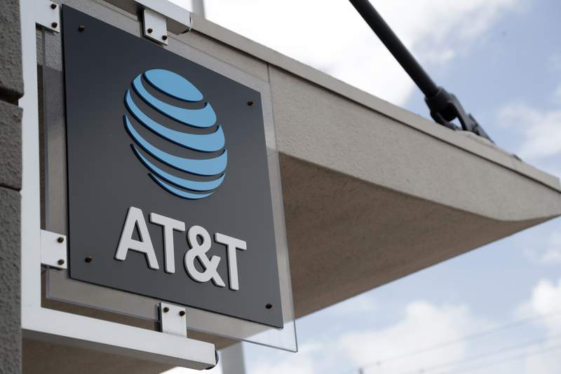 FILE - In this July 18, 2019, file photo, a sign is displayed at an AT&T retail store in Miami. Corporations have given more than $50 million in recent years to state lawmakers who have seized on Donald Trumps lies about a stolen 2020 election to push for new restrictions on the right to vote. That's according to a new report by the government watchdog nonprofit Public Citizen. Telecom-giant AT&T was the most prolific giver, donating over $800,000 since 2015 to authors of proposed restrictions, co-sponsors of such measures, or those who voted in favor of the bills, a new report by the Washington-based non-profit Public Citizen found. (AP Photo/Lynne Sladky, File)