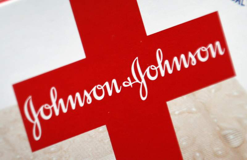 FILE - This Oct. 16, 2012 file photo shows the Johnson & Johnson logo on a package of Band-Aids, in St. Petersburg, Fla. The World Health Organization on Friday, March 12, 2021 granted an emergency use listing for the coronavirus vaccine made by Johnson & Johnson, meaning the one-dose shot can now theoretically be used as part of the international COVAX effort to distribute vaccines globally, including to poor countries without any supplies. (AP Photo/Chris O'Meara, File)
