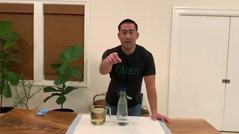 """In this April 11, 2020 image from video, Kauai Mayor Derek Karakami introduces his latest """"Stay Home, Kauai"""" video aimed at keeping his county informed and entertained after implementing a curfew to help curb the spread of coronavirus. (Derek Kawakami via AP)"""