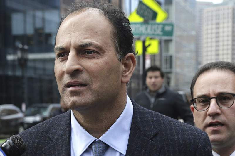 FILE - March 15, 2019, David Sidoo, of Vancouver, Canada, leaves following his federal court hearing in a nationwide college admissions cheating scheme in Boston. Sidoo pleaded guilty to a mail fraud conspiracy charge in Boston federal court on Friday, March 13, 2020. (Jonathan Wiggs/The Boston Globe via AP, File)