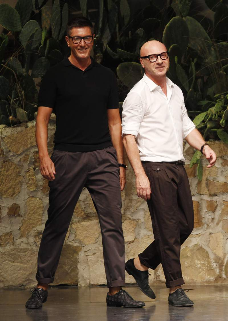 FILE -- In this June 23, 2012 file photo Italian fashion designers Stefano Gabbana, left, and Domenico Dolce take the catwalk after presenting their Dolce & Gabbana men's fashion collection in Milan, Italy.  (AP Photo/Luca Bruno, file)