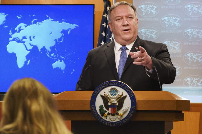 FILE - In this Nov. 10, 2020 file photo, Secretary of State Mike Pompeo gestures toward a reporter while speaking at the State Department in Washington. Pompeo plans to deliver a speech extolling the Trump administration's foreign policy this week in Georgia ahead of key Senate run-off elections that will determine control of the upper chamber of Congress. Pompeo will address threats posed by China in an address to Georgia Tech on Wednesday, according to the university. (AP Photo/Jacquelyn Martin, Pool)