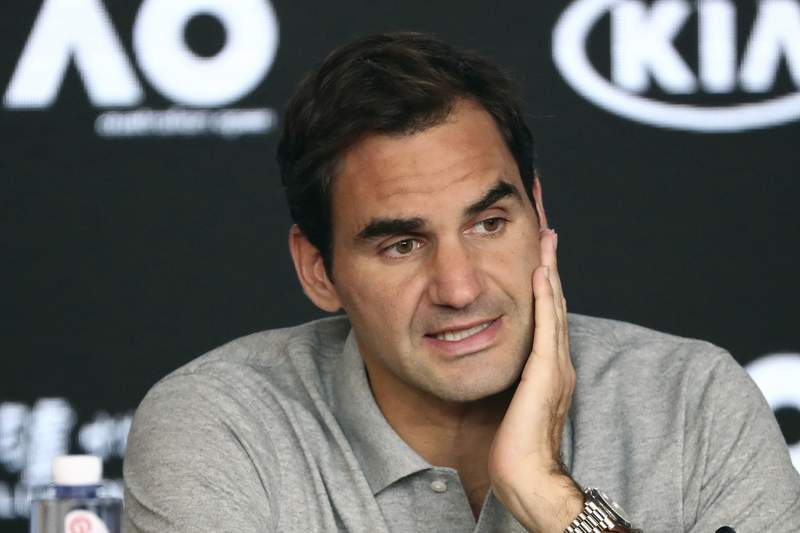 FILE - In this Jan. 30, 2020, file photo, Switzerland's Roger Federer speaks during a press conference following his semifinal loss to Serbia's Novak Djokovic at the Australian Open tennis championship in Melbourne, Australia. Federer is withdrawing from this month's Miami Open so he can spend extra time preparing to work his way back out on tour, his agent told The Associated Press on Monday, March 1, 2021. (AP Photo/Dita Alangkara, File)