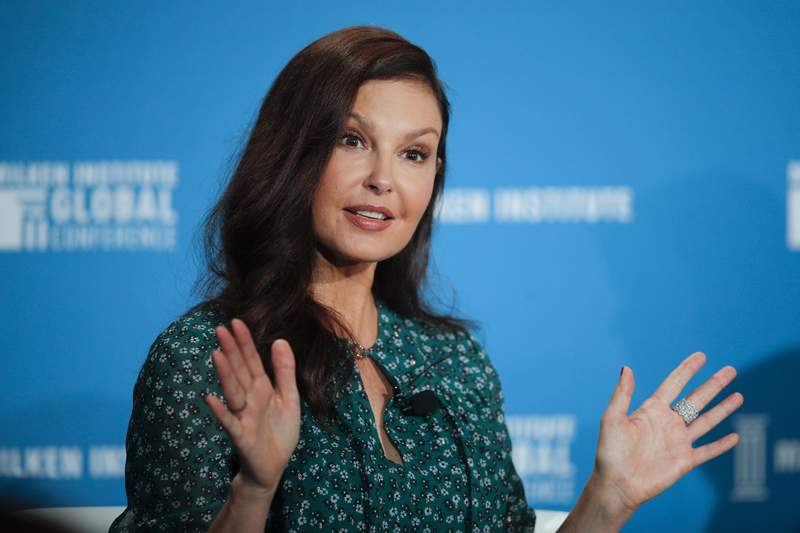 FILE - In this April 30, 2018, file photo, actress Ashley Judd speaks during a discussion on feminism at the Milken Institute Global Conference in Beverly Hills, Calif. Judd has recounted a painful ordeal that she believes almost cost her leg after tripping in a Congolese rainforest and having to be evacuated by motorbike. In one of two Instagram Live videos hosted Friday, Feb. 12, 2021, by New York Times columnist Nicholas Kristof, the actor said she was stuck on the ground for five hours with a badly misshapen leg, biting a stick because of pain, and howling like a wild animal. (AP Photo/Jae C. Hong, File)