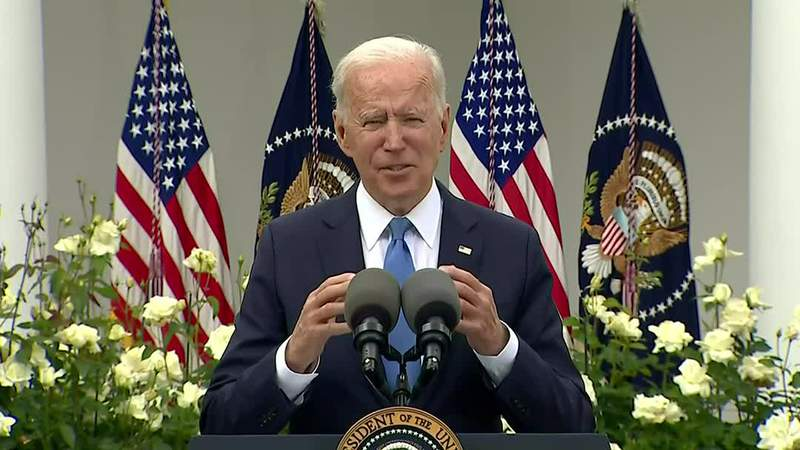Pres. Joe Biden reacts to new CDC-issued mask