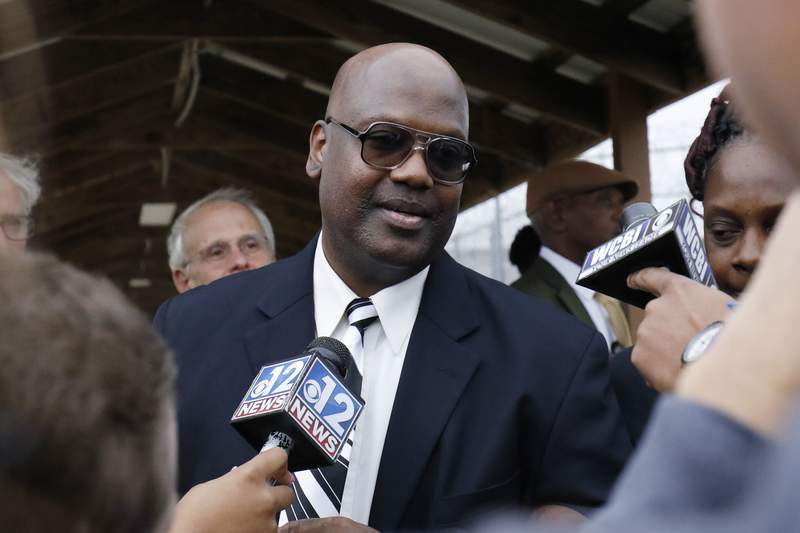FILE - In this Dec. 16, 2019 file photo, Curtis Flowers speaks with reporters as he exits the Winston-Choctaw Regional Correctional Facility in Louisville, Miss.  Flowers freed after nearly 23 years in prison is suing the district attorney who prosecuted him six times in the killings of four people at furniture store. Attorneys for Flowers filed the lawsuit Friday, Sept. 3, 2021, seeking an unspecified amount of compensation. (AP Photo/Rogelio V. Solis, File)