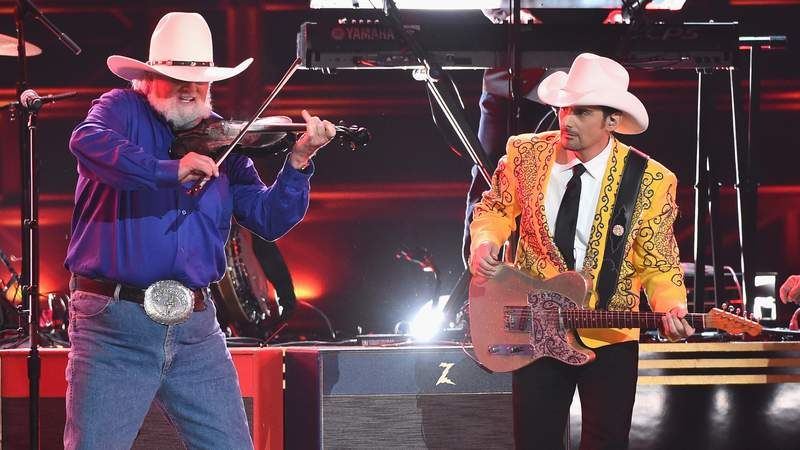 Charlie Daniels and Brad Paisley perform onstage at the 50th annual CMA Awards at the Bridgestone Arena on November 2, 2016 in Nashville, Tennessee. (Photo by Rick Diamond/Getty Images)