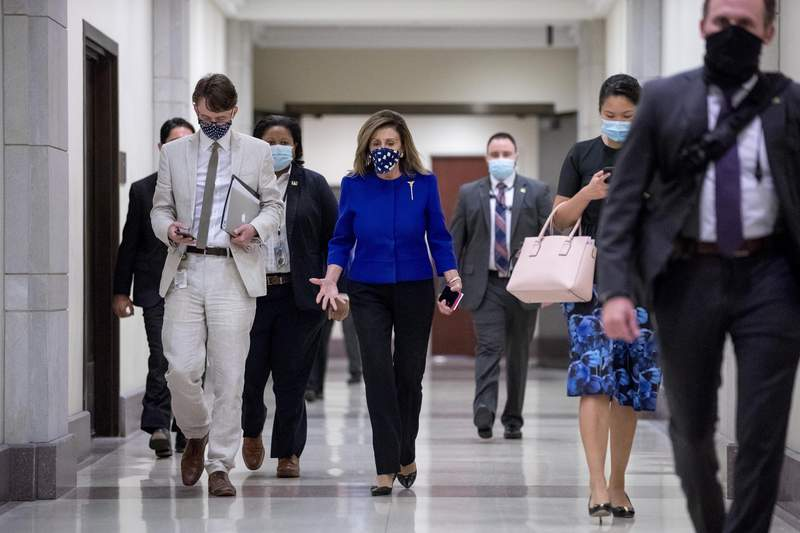 House Speaker Nancy Pelosi of Calif. arrives at a news conference on Capitol Hill in Washington, Friday, July 24, 2020, on the extension of federal unemployment benefits. (AP Photo/Andrew Harnik)