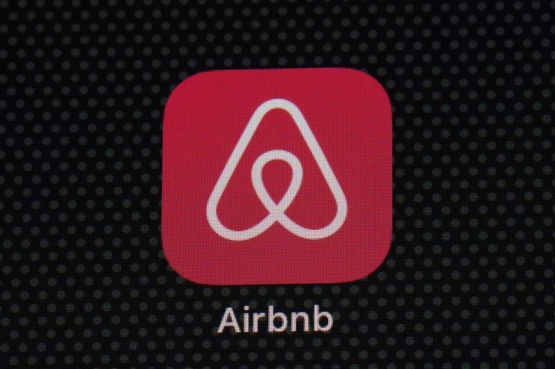 The Airbnb app icon is seen on an iPad screen, Saturday, May 8, 2021, in Washington. Airbnb reported Thursday, May 13 that its first-quarter loss more than tripled, to $1.17 billion, as travel remained depressed by the pandemic, but revenue topped the same period in 2019. (AP Photo/Patrick Semansky)