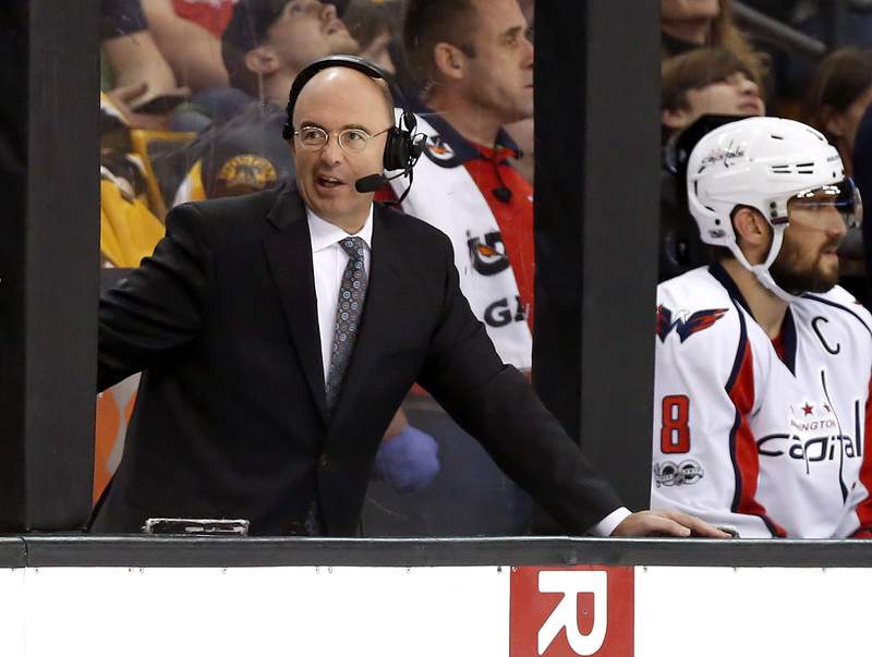 FILE - Pierre McGuire broadcasts during the third period of an NHL hockey game between the Boston Bruins and the Washington Capitals in Boston, in this Saturday, April 8, 2017, file photo. Longtime television analyst Pierre McGuire is returning to an NHL front office as senior vice president of player development for the Ottawa Senators. The club announced McGuire's appointment Monday morning, July 12, 2021. (AP Photo/Winslow Townson, File)