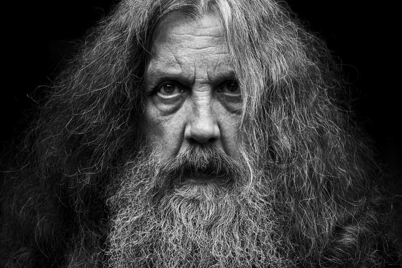 """This photo provided by Bloomsbury Publishing shows Alan Moore. The celebrated British author known for V for Vendetta and Watchman among other works has a deal with Bloomsbury for the story collection Illuminations and a five-volume fantasy series, Long London. In a statement Monday, May 3, 2021, Moore said he was bursting with fiction, bursting with prose"""" and thanked his publisher for its commitment to expanding the empire of the word.   (Bloomsbury Publishing/Mitch Jenkins via AP)"""