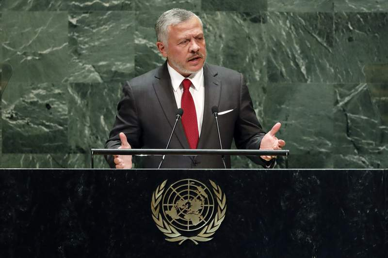 FILE - In this Sept. 24, 2019, file photo, Jordan's King Abdullah II addresses the 74th session of the United Nations General Assembly. The Trump administration is considering withholding aid to one of its closest Arab partners, Jordan, in a bid to secure the extradition of a woman convicted in Israel of a 2001 bombing that killed 15 people, including two American citizens. The extradition issue is likely to be raised this week when King Abdullah II speaks to several congressional committees to voice his opposition to Israels plans to annex portions of the West Bank. (AP Photo/Richard Drew, File)