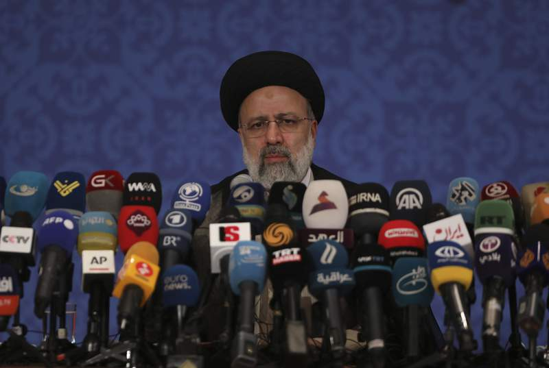 FILE - This Monday, June 21, 2021 photo shows Iran's new President-elect Ebrahim Raisi during a news conference in Tehran, Iran.  Iran said Tuesday, June 22, that several state-linked news websites have been seized by the U.S. government under unclear circumstances.   While there was no immediate acknowledgement of the seizures from American authorities, it comes amid the wider heightened tensions between the U.S. and Iran over Tehran's now-tattered nuclear deal with world powers. (AP Photo/Vahid Salemi, File)