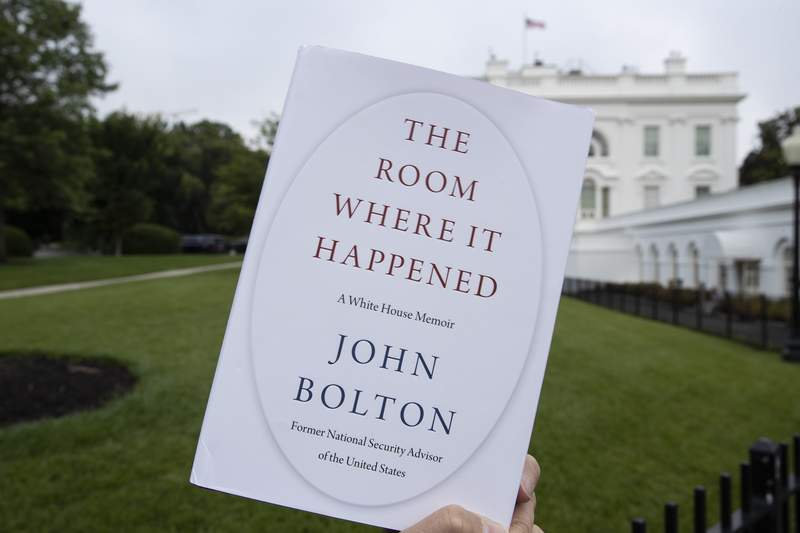 """FILE - In this June 18, 2020, file photo a copy of """"The Room Where It Happened,"""" by former national security adviser John Bolton, is photographed at the White House in Washington. Trump administration officials repeatedly exerted political pressure in an unsuccessful effort to block the release of former national security adviser John Boltons tell-all book, a career government records professional said in a court filing Wednesday, Sept. 23. (AP Photo/Alex Brandon, File)"""