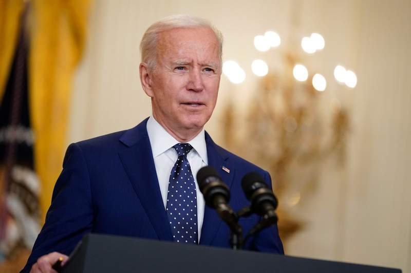 FILE - In this April 15, 2021, file photo, President Joe Biden speaks in the East Room of the White House in Washington. As the delta variant fuels an increase of COVID-19 cases in the U.S., some of President Joe Biden's critics blame the surge on his border policies, which allow some migrants to enter the country to apply for asylum. (AP Photo/Andrew Harnik, File)