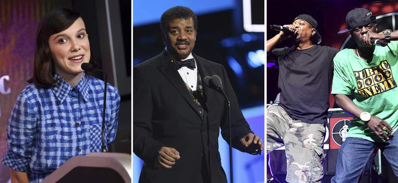 """This combination photo shows Millie Bobby Brown, from left, Neil deGrasse Tyson and Public Enemy's Chuck D and Flavor Flav. This week's new entertainment releases include """"Stranger Things"""" breakout star Brown getting her first starring role in the Netflix film """"Enola Holmes,"""" Neil deGrasse Tyson spreads his wisdom on Fox and Public Enemy releases """"What You Gonna Do When the Grid Goes Down?"""" (AP Photo)"""