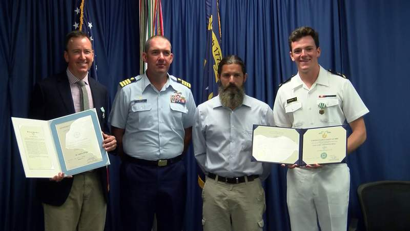 Family who rescued boater honored by Coast Guard