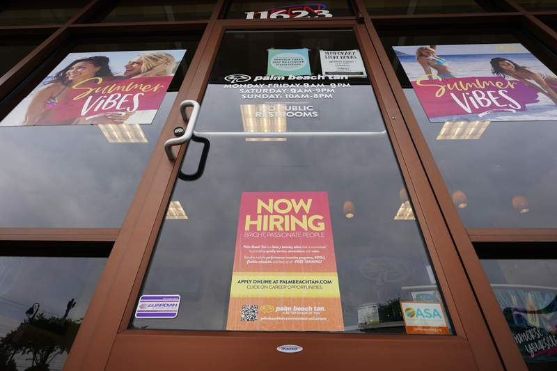 FILE - A Now Hiring sign at a business in Richmond, Va., Wednesday, June 2, 2021. U.S. employers posted a record 10.1 million job openings in June, another sign that the job market and economy are bouncing back briskly from last years coronavirus shutdowns. The Labor Department reported Monday, Aug. 9, 2021 that job openings rose from 9.5 million in May. (AP Photo/Steve Helber)