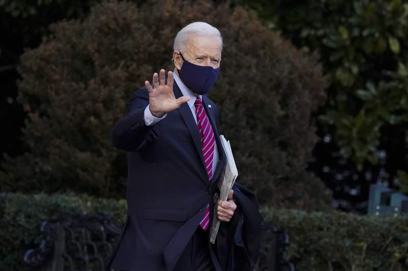President Joe Biden waves as he walks to board Marine One on the South Lawn of the White House, Friday, Feb. 5, 2021, in Washington. (AP Photo/Alex Brandon)