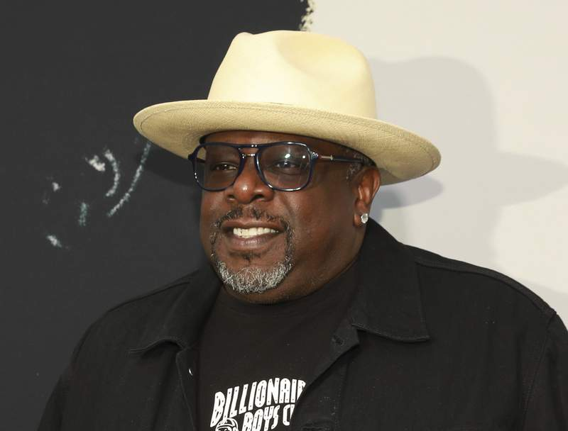 """FILE - Cedric the Entertainer appears at the world premiere of the """"Black Godfather"""" in Los Angeles on June 3, 2019. Cedric the Entertainer will host the Emmy Awards in September as the ceremony returns to a live telecast after last years pandemic-forced virtual event. There will be a limited audience of nominees and guests at the Microsoft Theatre for the Sept. 19 show airing on CBS. (Photo by Mark Von Holden/Invision/AP, File)"""