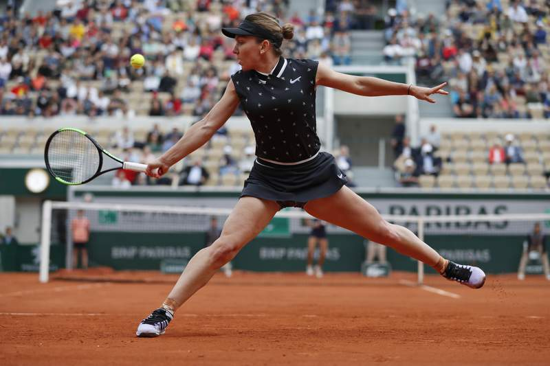 FILE - In this Thursday, May 30, 2019, file photo, Romania's Simona Halep plays a shot against Poland's Magda Linette during their second round match of the French Open tennis tournament at Roland Garros stadium in Paris. (AP Photo/Jean-Francois Badias, File)