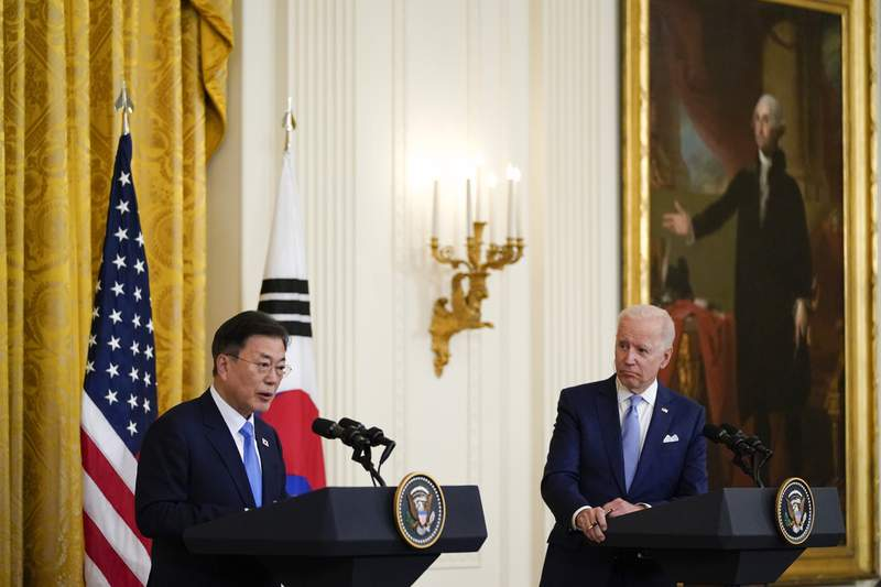 FILE - In this May 21, 2021, file photo, President Joe Biden listens as South Korean President Moon Jae-in speaks during a joint news conference in the East Room of the White House, in Washington. North Korea said Monday, May 31, the U.S. allowing South Korea to build more powerful missiles was an example of the U.S.'s hostile policy against the North, warning that it could lead to an acute and instable situation on the Korean Peninsula.(AP Photo/Alex Brandon, File)