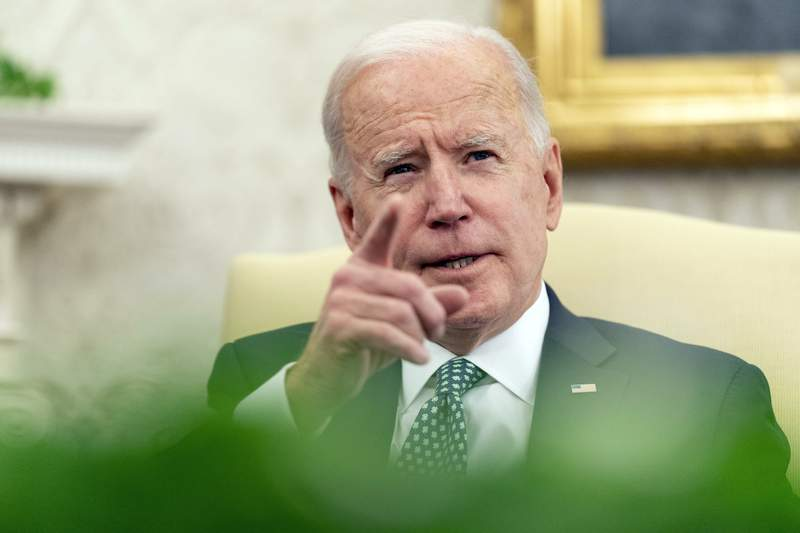 FILE - In this March 17, 2021 photo, President Joe Biden speaks in the Oval Office of the White House in Washington. Biden intends to nominate three African American prosecutors to run the U.S. attorneys offices in New York, including the first Black man to run the Southern District of New York. That's according to a person familiar with the matter who spoke to The Associated Press on Tuesday.  (AP Photo/Andrew Harnik)