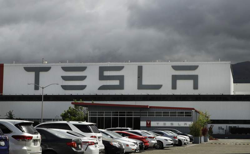 FILE - This May 12, 2020 file photo photo shows the Tesla plant in Fremont, Calif.  Teslas third-quarter sales rose 44% from a year ago as global demand for its electric vehicles proved stronger than most other automakers. The company said it delivered 139,000 SUVs and sedans from July through September compared with 97,000 deliveries during the same period a year ago. (AP Photo/Ben Margot, File)