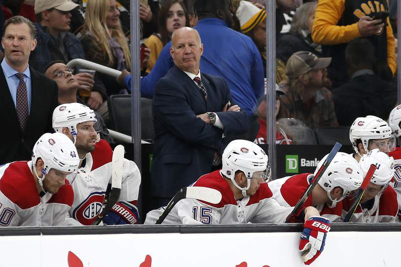 FILE - Montreal Canadiens head coach Claude Julien, center, looks on from the bench during the third period of an NHL hockey game in Boston, in this, Sunday, Dec. 1, 2019, file photo.  The Canadiens lost 3-1. The struggling Montreal Canadiens fired head coach Claude Julien and associate coach Kirk Muller on Wednesday, Feb. 24, 2021, following a three-game skid. Assistant coach Dominique Ducharme was appointed interim coach.(AP Photo/Winslow Townson, File)