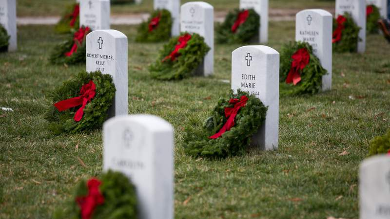FILE: Wreaths lay at the foot of headstones in Section 60 of Arlington National Cemetery, December 14, 2013 in Arlington, Virginia. Volunteers and families of the fallen placed thousands of remembrance wreaths on headstones throughout the cemetery on National Wreaths Across America Day. (Photo by Drew Angerer/Getty Images)