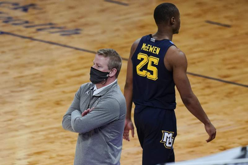 FILE - In this March 10, 2021, file photo, Marquette coach Steve Wojciechowski, left, watches the team play, while Koby McEwen (25) heads to the bench after fouling out of the game during the second half of an NCAA college basketball game against Georgetown in the Big East conference tournament in New York. Marquette fired Wojciechowski on Friday, March 19, after a seven-season tenure in which he went 128-95 but earned no NCAA Tournament victories(AP Photo/Frank Franklin II)