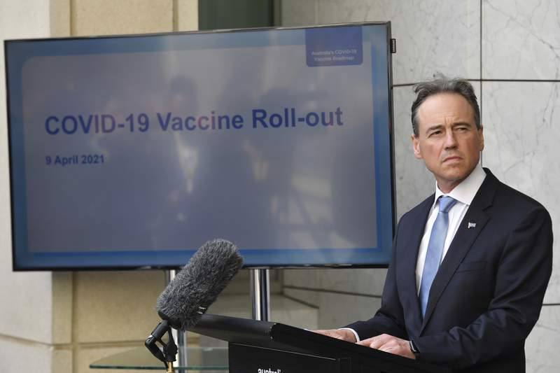 Australia's Health Minister Greg Hunt discusses the COVID-19 vaccination program at a press conference at Parliament House in Canberra, Friday, April 9, 2021. The Australian government has decided, Tuesday, April 13, 2021, against buying the single-dose Johnson & Johnson coronavirus vaccine as a way to accelerate its immunization program. (Mick Tsikas/AAP Image via AP)