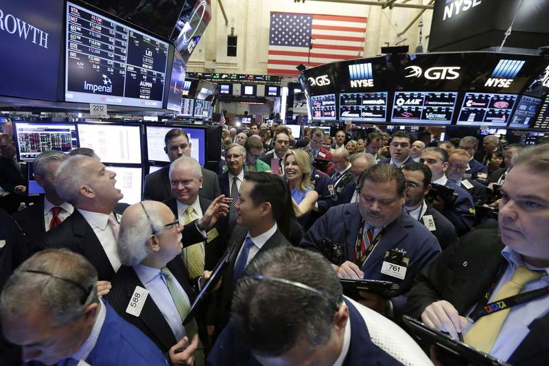 FILE - New York Stock Exchange floor governor Rudy Maas, left, calls out prices during the IPO of MGM Growth Properties on the floor of the NYSE, Wednesday, April 20, 2016. Wall Street has rolled out the welcome mat for companies going public this year, boosting proceeds from initial public offerings to the highest level in six years. Companies that have gone public this year have averaged a return of 53.8% above their IPO price, including a return of 23.4% after their first day of trading, according to Renaissance Capital, an IPO research provider. (AP Photo/Richard Drew, file)