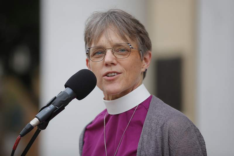 FILE - Bishop Mariann Edgar Budde of the Esiscopal Diocese of Washington speaks during a service outside St. John's Episcopal Church in Washington, in a Friday, June 19, 2020 file photo. The Democratic Party is tapping a diverse group of faith leaders to speak at its presidential nominating convention this week. Among those speakers is Bishop Mariann Budde of the Episcopal Diocese of Washington, who will deliver the benediction on Tuesday, the second night of the Democratic convention.(AP Photo/Carolyn Kaster, File)