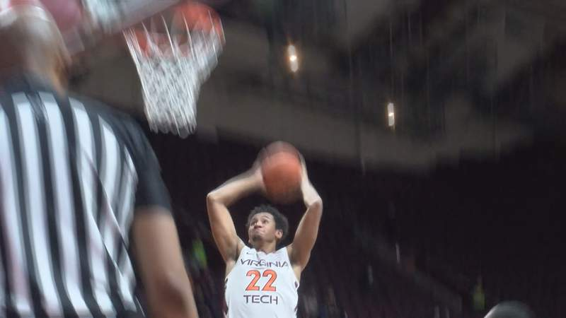 Hokies Keve Aluma dunks 2 of his 13 points as Virginia Tech topples #24 Clemson.