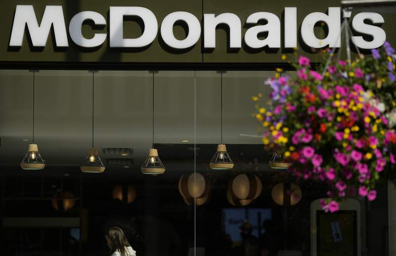 A customer walks in a McDonald's restaurant, in London, Tuesday, Aug. 24, 2021. McDonalds says it has pulled milkshakes from the menu in all 1,250 of its British restaurants because of supply problems stemming from a shortage of truck drivers. The fast-food chain says it is also experiencing shortages of bottled drinks. (AP Photo/Alastair Grant)