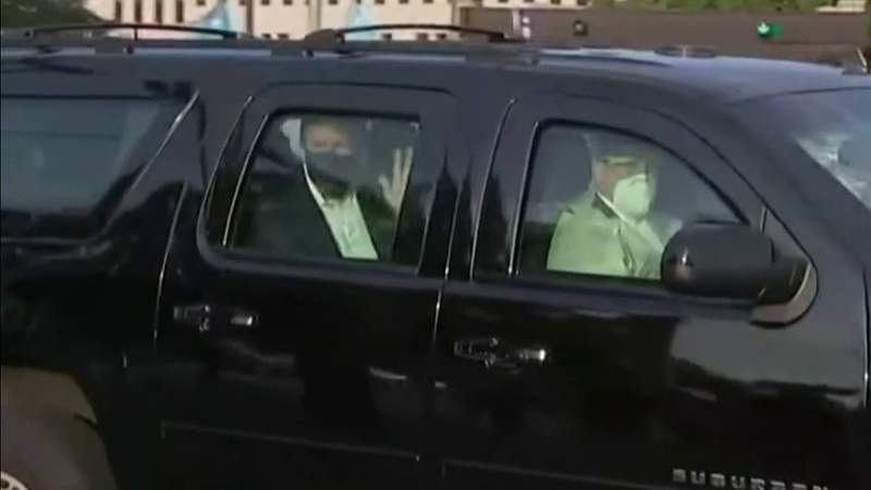 The president leaves quarantine at Walter Reed to greet supporters outside of the hospital on Sunday, Oct. 4.