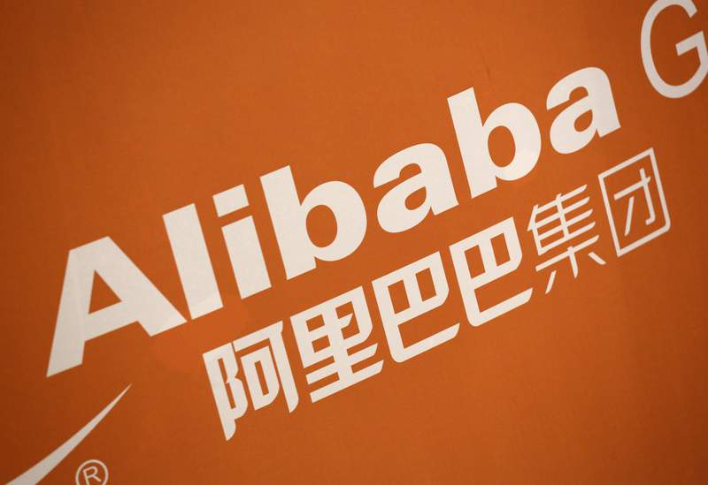 FILE - In this Sept. 19, 2014, file photo, the Alibaba logo is displayed during the company's IPO at the New York Stock Exchange.  Chinas biggest e-commerce firm Alibaba Group Holding reported a 30% jump, Thursday, Nov. 5, 2020,  in quarterly revenue, as China recovers from the virus and online shopping demand remains high.   (AP Photo/Mark Lennihan, File)