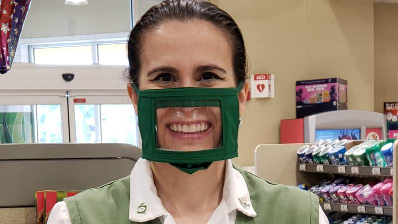 Asli Knowles, a Publix employee in Vero Beach, Florida, shows a specially designed mask for deaf people created by Brian Tavers, owner of Anchor Handmade Designs. Contributed photo