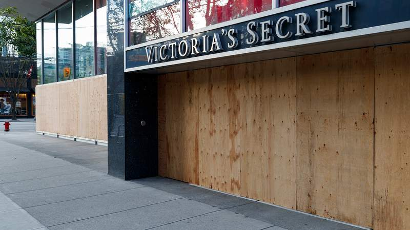 A view of Victoria's Secret storefront closed and boarded up on Robson Street during the COVID-19 crisis on April 17, 2020 in Vancouver, Canada. All non-essential retail has been closed to slow the spread of Coronavirus (COVID-19) (Photo by Andrew Chin/Getty Images)