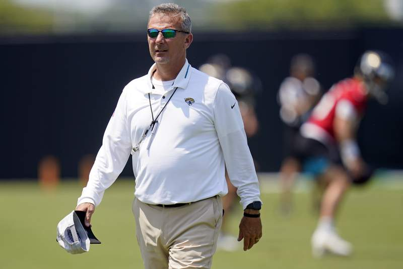 Jacksonville Jaguars head coach Urban Meyer watches players go through drills during an NFL football team practice, Thursday, May 27, 2021, in Jacksonville, Fla. (AP Photo/John Raoux)