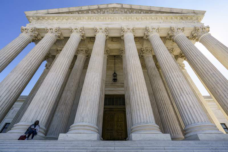FILE - In this Oct. 7, 2020, file photo the Supreme Court in Washington. After more than a decade in which the Supreme Court moved gradually toward more leniency for minors convicted of murder, the justices have moved the other way. The high court ruled 6-3 Thursday along ideological lines against a Mississippi inmate sentenced to life in prison without the possibility of parole for fatally stabbing his grandfather when the defendant was 15 years old. The case is important because it marks a break with the courts previous rulings and is evidence of the impact of a newly more conservative court.(AP Photo/J. Scott Applewhite, File)
