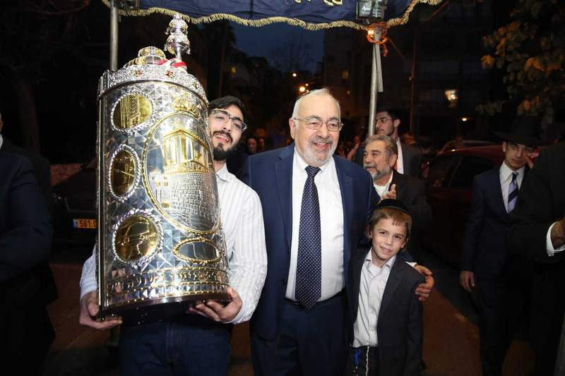 This undated photo shows Simha Benshai, center, at synagogue celebration with relatives in Tel Aviv, Israel. Benshai, 75, died from coronavirus at a Tel Aviv hospital. (Elisheva Stern via AP)