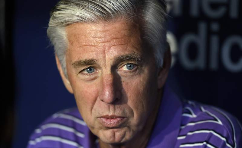 FILE - In this April 19, 2019, file photo, Boston Red Sox general manager Dave Dombrowski talks before the team's baseball game against the Tampa Bay Rays in St. Petersburg, Fla. The Philadelphia Phillies have hired Dombrowski as president of baseball operations, according to two people familiar with the decision. The people spoke to The Associated Press on condition of anonymity because the team hasnt announced the hiring. (AP Photo/Chris O'Meara, File)