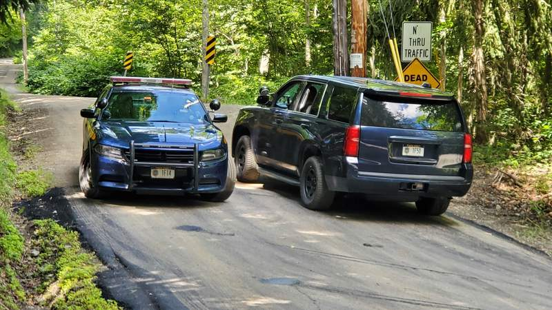 """New York State Police block off a road near the scene where the body of Roy Den Hollander was found on Monday, July 20, 2020 near Livingston Manor, N.Y. Hollander, a self-described """"anti-feminist"""" lawyer found dead in the Catskills of an apparent self-inflicted gunshot wound, is being investigated as the possible gunman in the shooting of a federal judge's family in New Jersey. (Jim Sabastian/The Times Herald-Record via AP)"""